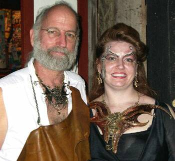 David Spurlock, the artist, with customer in dragon chestplate.